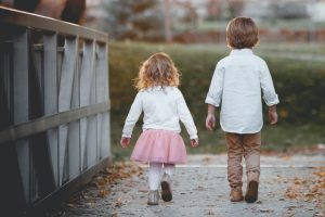 A boy and girl walking